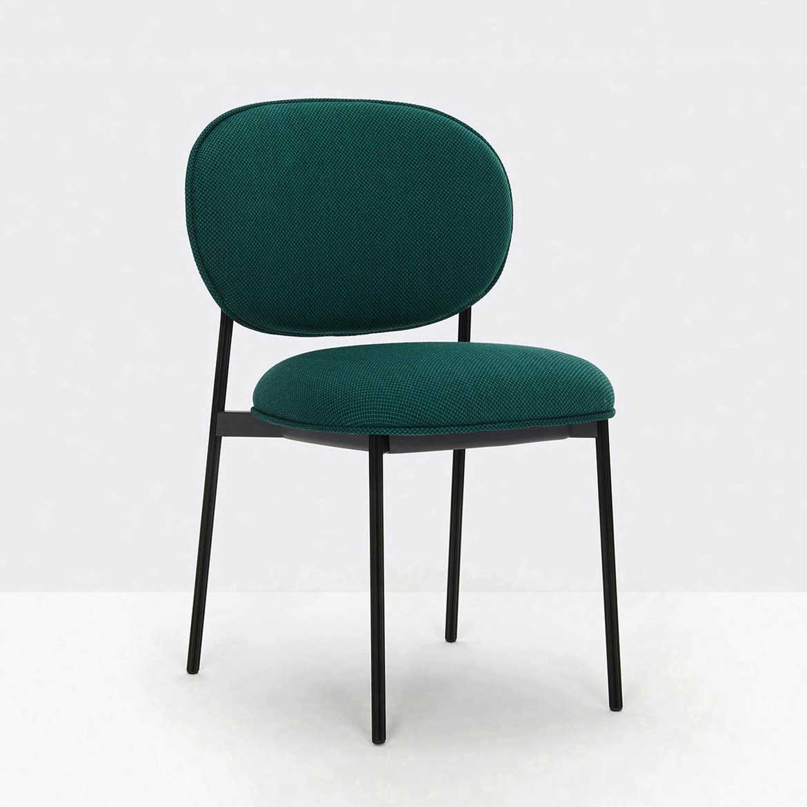 Chair with metal fram in different finishes. Seat and backrest upholstered with fabric, leather or simil-leather in many colours. Stackable.